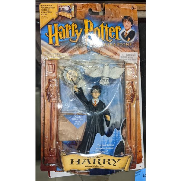 2 Collectibe Harry Potter and the Socerer's Stone action figures (Invisibility Cloak and Harry Potte