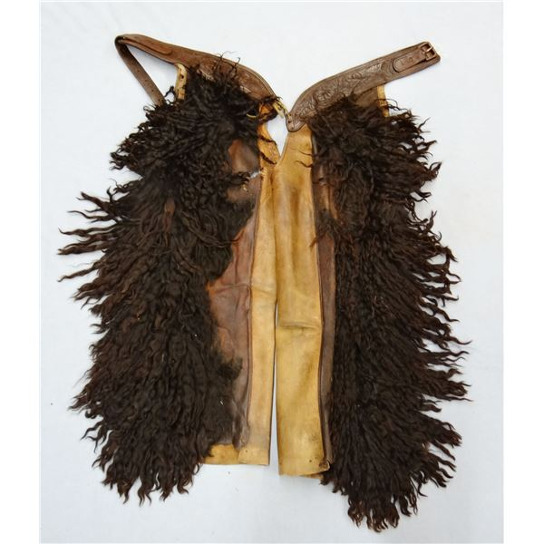 Black woolie chaps, unmarked, fair condition