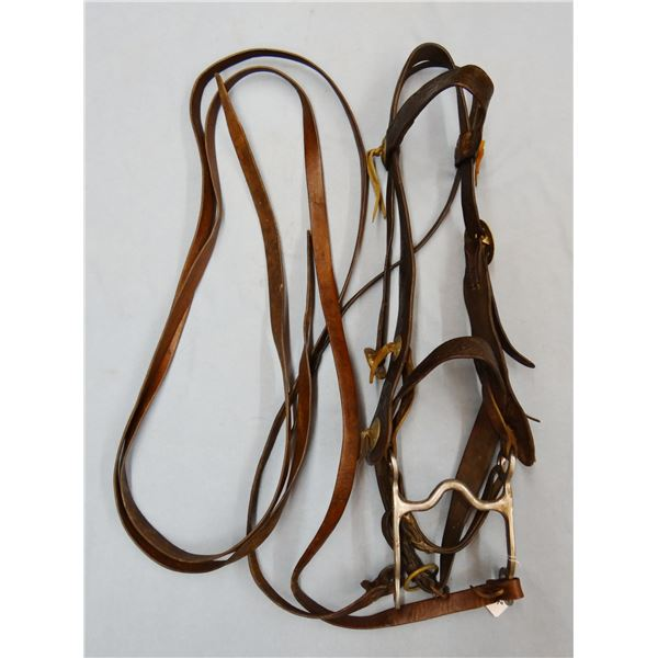 ST stainless grazing bit in fancy flower tooled vintage bridle