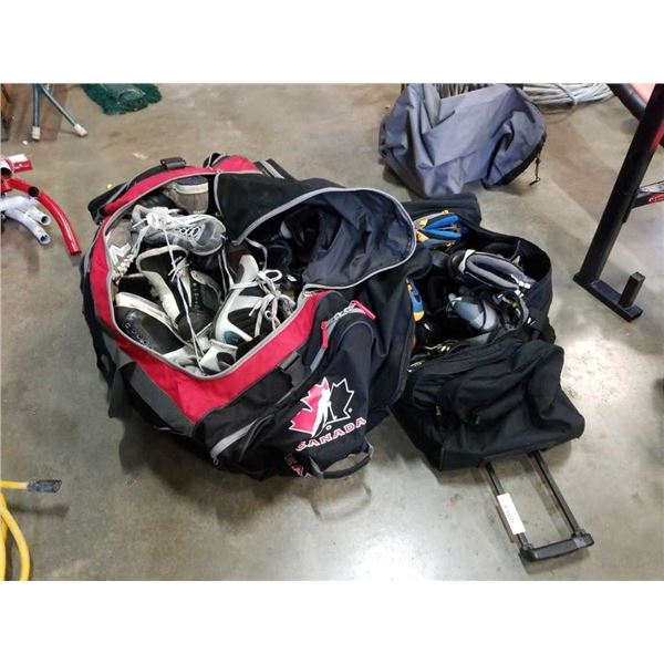 Two hockey bags of various and Rollerblades and cleats