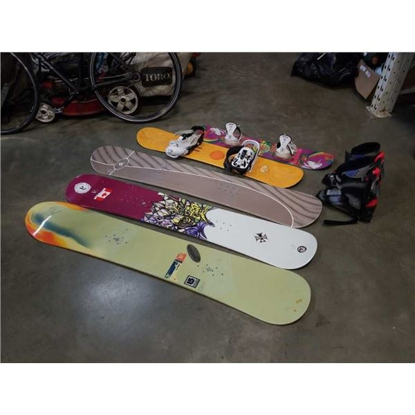 5 snow boards and pair of boots