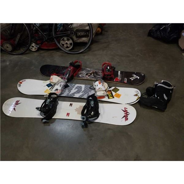 3 snow boards and pair of boots