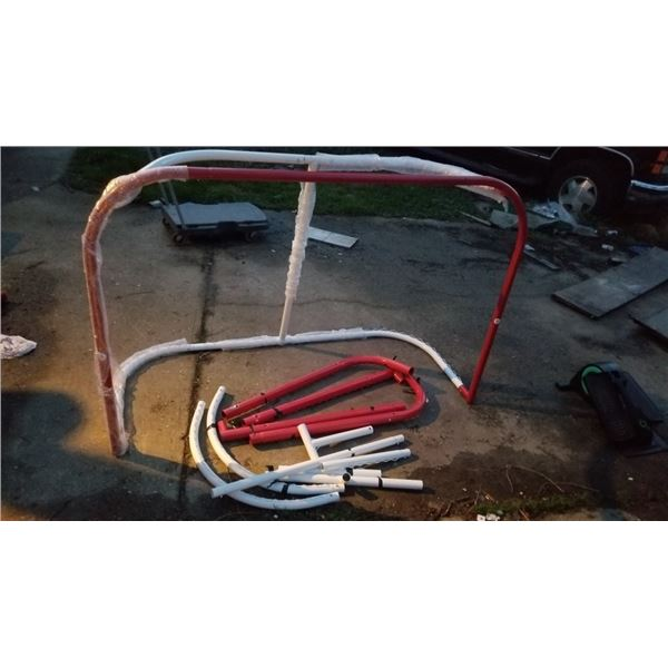 As new 6 foot by 4 foot steel hockey net with extra parts