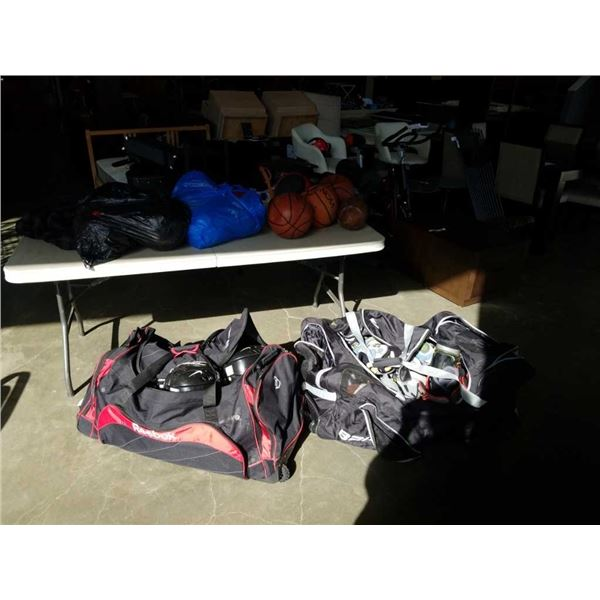 2 HOCKEY BAGS OF BASKETBALLS, SPORTING GOODS