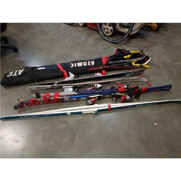 Lot of cross country, downhill and other skiis