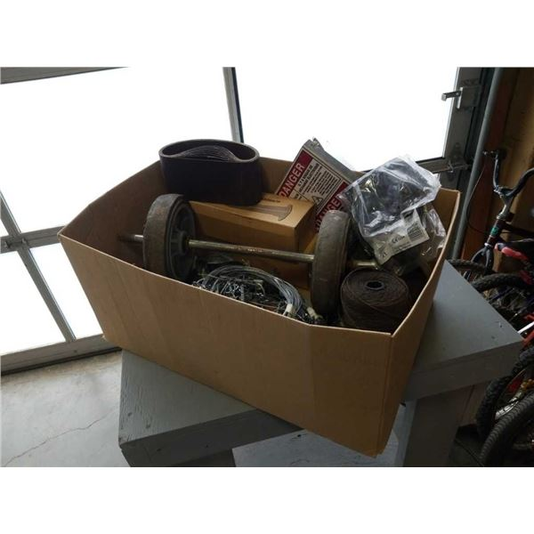 Box of picture hanging wire, twine, sanding belts and more