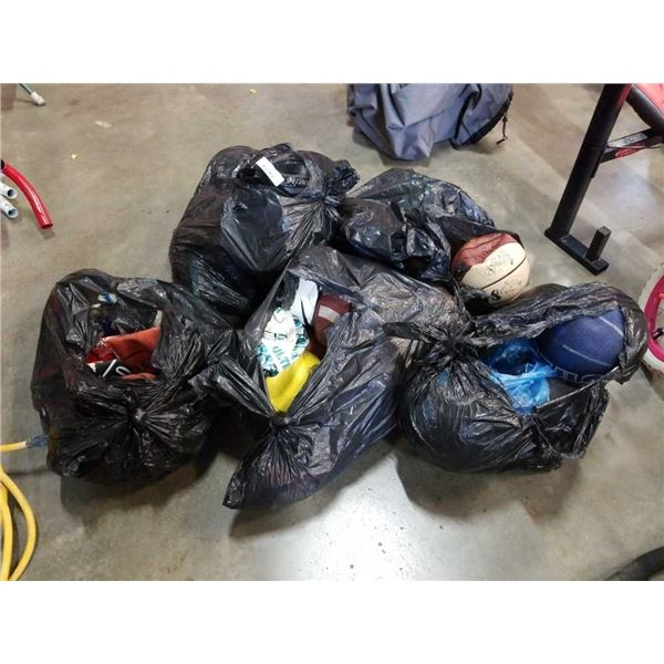 Lot of sports balls and sports helmets