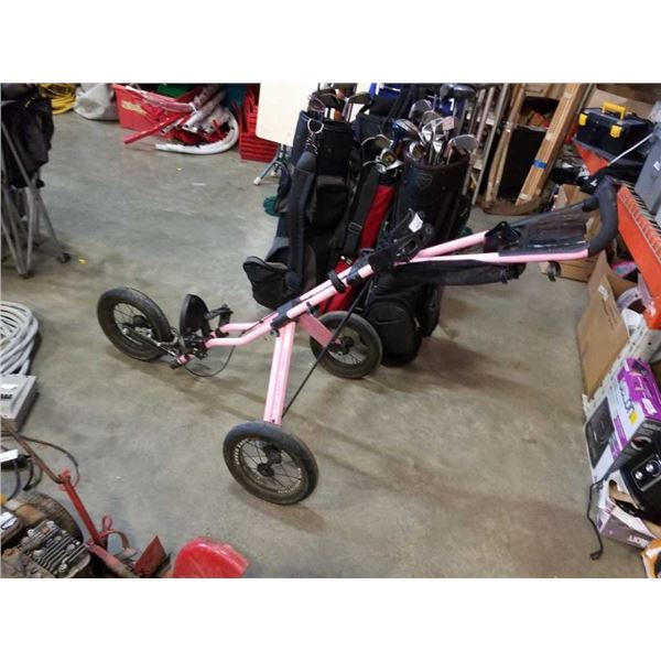Folding pink sun mountain golf cart