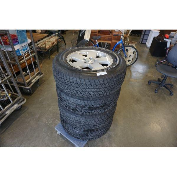 Set of four bridgestone dueller P255 70 R18 tires on aluminum jeep 5 x 127 bolt pattern rims