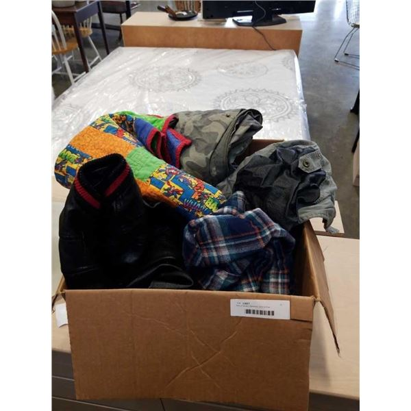 Box of books, blankets, and clothes