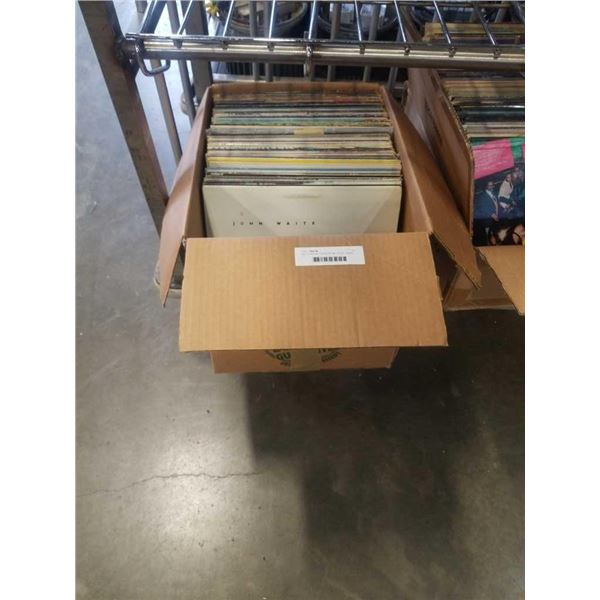 Box of records: Rolling Stones, AC/DC, Jethro Tull, Nazareth and others