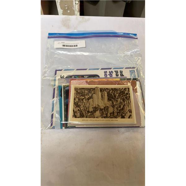 Bag of vintage postcards and stamp books