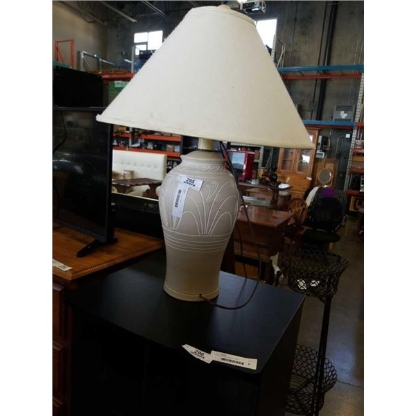 Carved wood lamp with shade