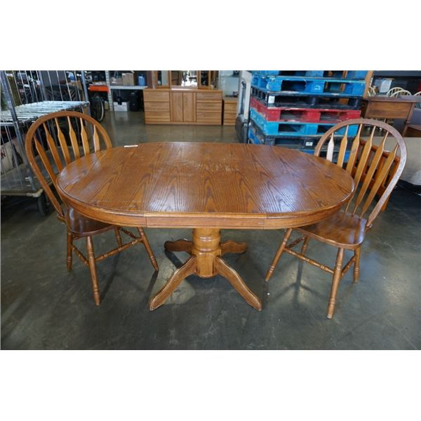 Round wood dining table with leaf and 2 chairs