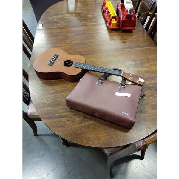 Montana 2653 kids acoustic guitar and bostanter handbag