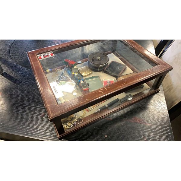 Display case with vintage collectibles