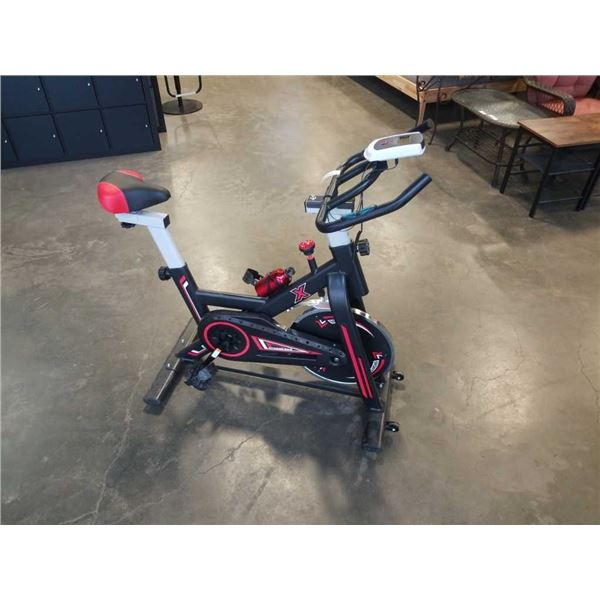 FLOOR MODEL  PCF SPIN BIKE W/ ADJUSTABLE SEAT AND BARS - RETAIL $999