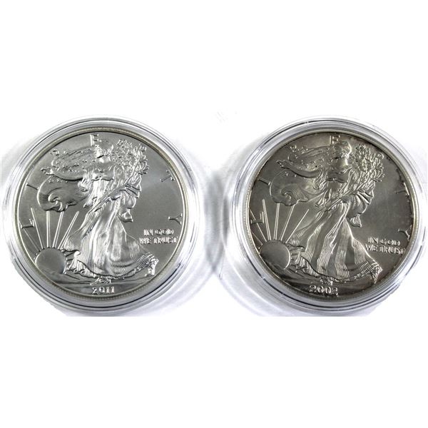 2002 & 2011 USA 1oz .999 Fine Silver Eagles in Capsules (Lightly toned & 2002 lightly scratched). 2p