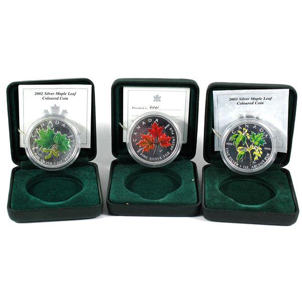 2001, 2002 & 2003 Canada 1oz Coloured Fine Silver Maples (2002 & 2003 coins are toned, capsules ligh