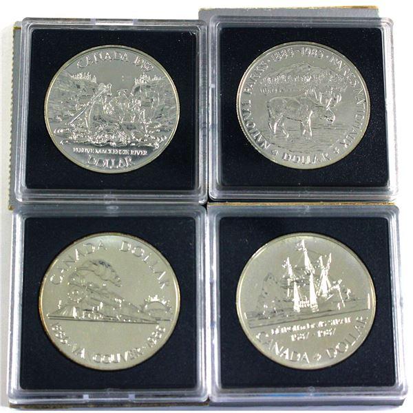 1985,1986,1987 & 1989 Canada Brilliant uncirculated silver Dollars. Each coin comes in their origina