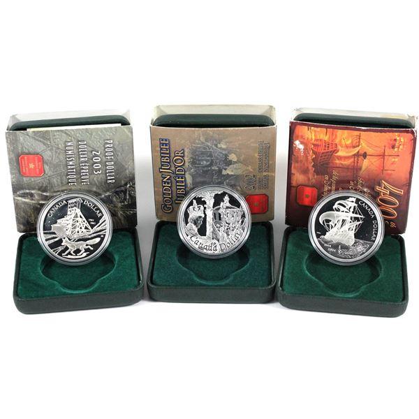 2002-2004 Canada commemorative proof silver dollars.  Each coin comes in their original square capsu