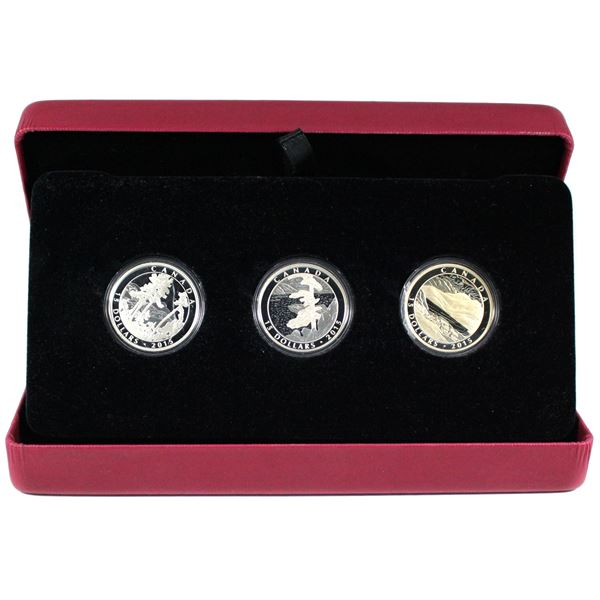 2015 Canada $15 Franklin Carmichael Fine Silver 3-coin Set (coins are toned and capsule is cracked).