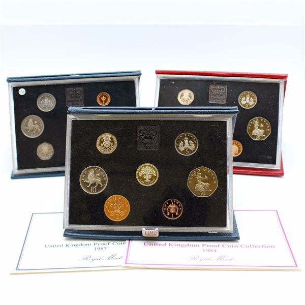 1984, 1985 & 1987 United Kingdom Proof set in original display and COA. Coins are toned and Inner li