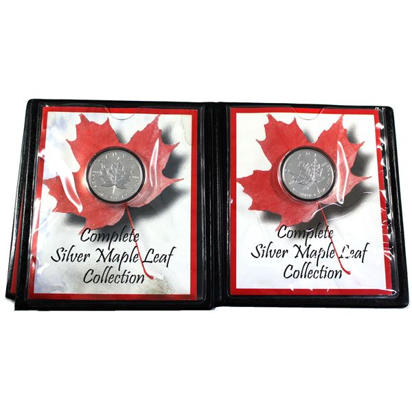Pair of 1oz Silver Maple leafs issued in deluxe black Folders made by First Commemorative Mint. Lot