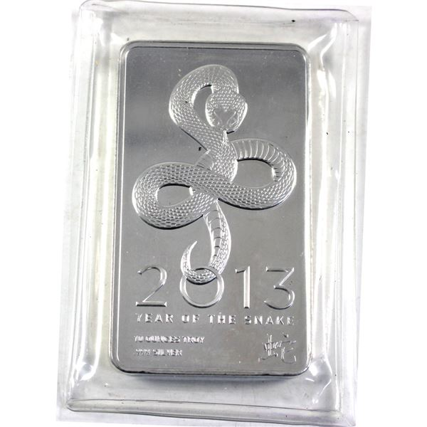2013 10oz Fine Silver Bar commemorating the Year of the Snake. Still sealed in Mint Pliofilm. (Tax E