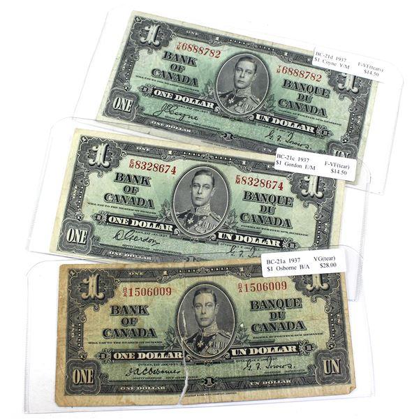 3x 1937 Bank of Canada $1 Banknotes - BC-21 Prefix B/A in VG, BC-21c Prefix E/M in F-VF & BC-21d Pre