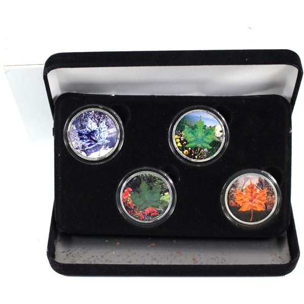 2003 Canada Four Seasons colourized 1oz Silver Maple Leaf 4-Coin Set. Very unique set. Item # 0133.