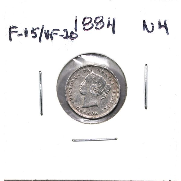 1884 Near 4 Canada 5-cent F-VF. Coin is impaired from being  previously mounted .