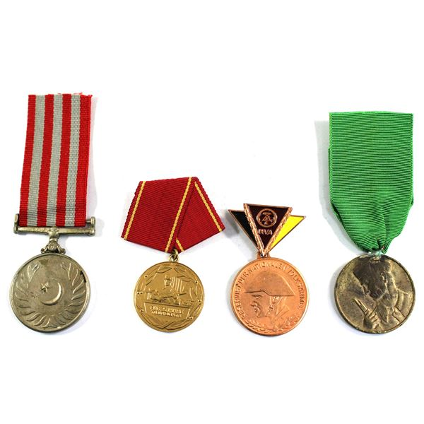 Lot of 4x International Medals. Some residue related to prior mounting. Includes East Germany Nation