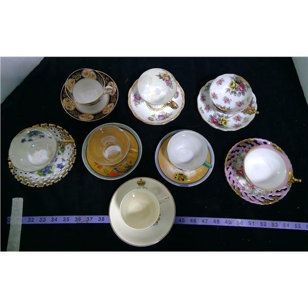 8 Teacups - 2 are 3 Legged