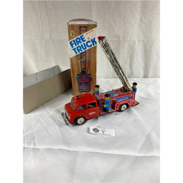 Vintage Fire Truck friction with siren in original box very good condition