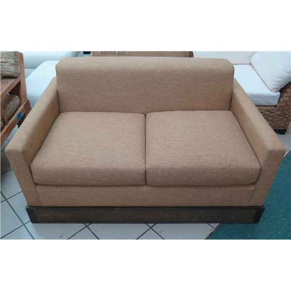 Tan Loveseat w/ Carved Wooden Base 60 x27 x26  Arm Ht.