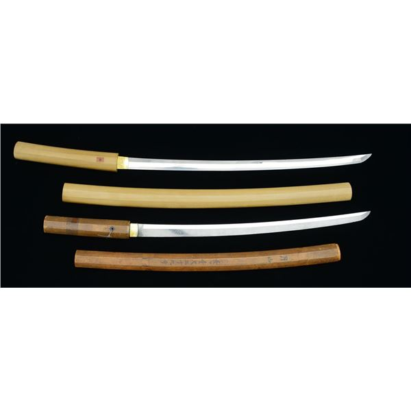 2 JAPANESE WAKIZASHI SWORD IN STORAGE MOUNTS.