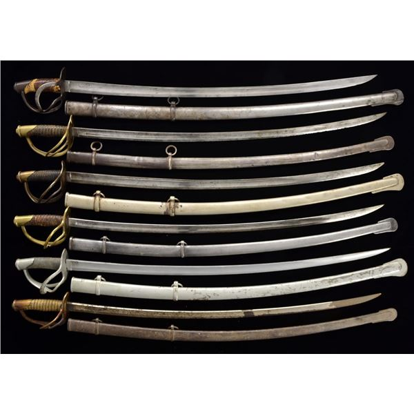 GROUP OF 11 CIVIL WAR CAVALRY SABERS.
