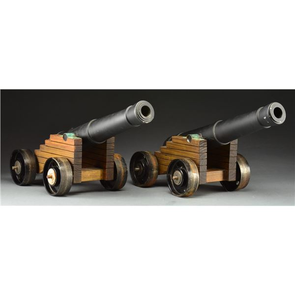 CONTEMPORARY PAIR OF CAST IRON MUZZLE LOADING