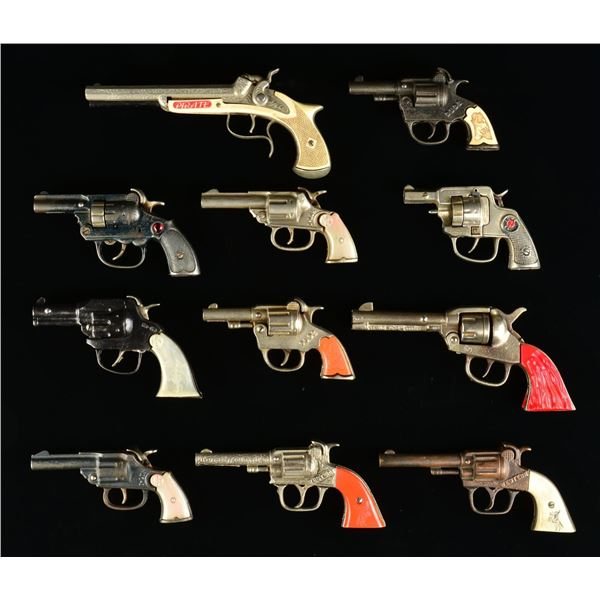 WONDERFUL COLLECTION OF CAST IRON TOY PISTOLS.