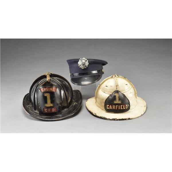 2 FIRE HELMETS, BADGES, HANDCUFFS & RELATED ITEMS.