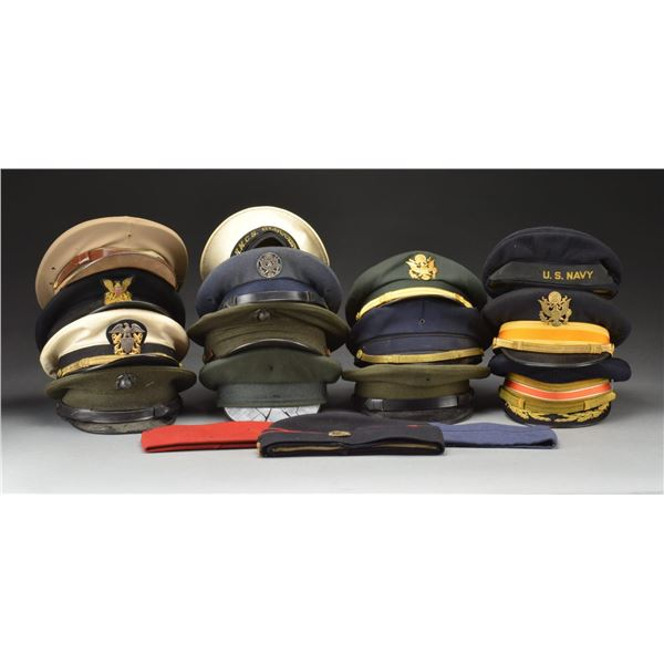 LARGE LOT OF MILITARY HATS MOSTLY OF THE WWII ERA.