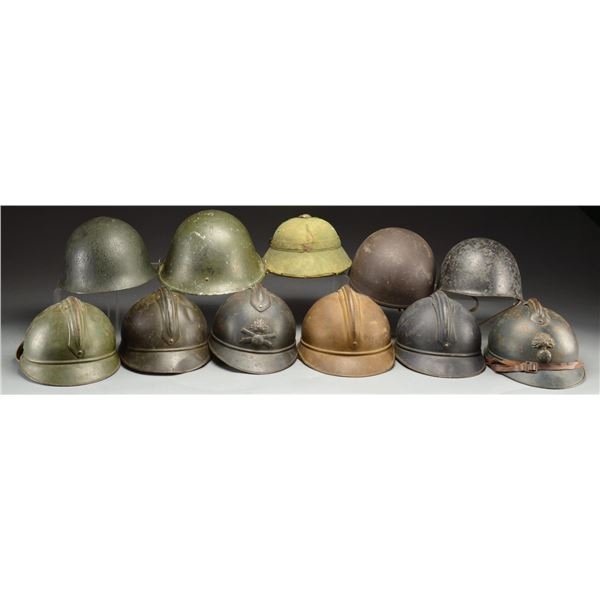 11 FOREIGN HELMETS.