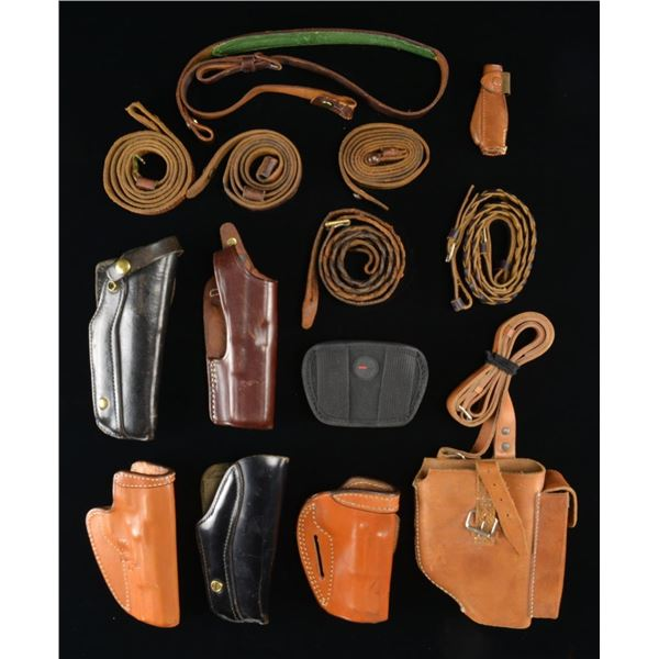 INTERESTING GROUP OF HOLSTERS & CARRYING STRAPS.