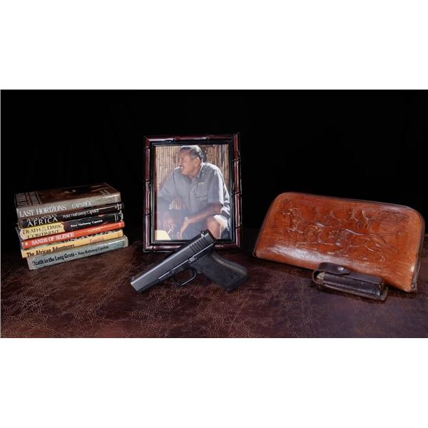 PETER HATHAWAY CAPSTICK'S PERSONAL GLOCK 17 IN 9MM, LEATHER CASE, AND BOOKS