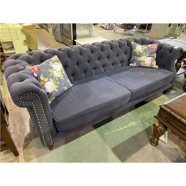 BLUE BUTTON BACK SOFA WITH 2 THROW FLORAL PRINT PILLOWS APPROX. 86  LONG