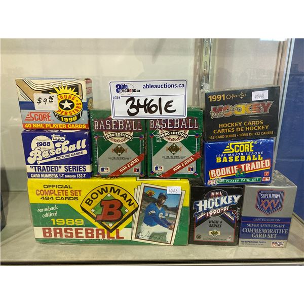 9 ASSORTED BOXES OF HOCKEY/BASEBALL/FOOTBALL CARDS ( 4 NEWLY SEALED) TOPPS, BOWMAN, SCORE,  UPPER
