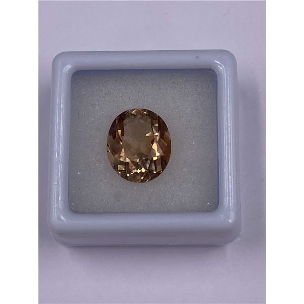 IMPERIAL TOPAZ 5.60CT, 12.16 X 10.23 X 6.17MM, OVAL CUT, CLARITY IF-LOUPE CLEAN, BRAZIL, CVD