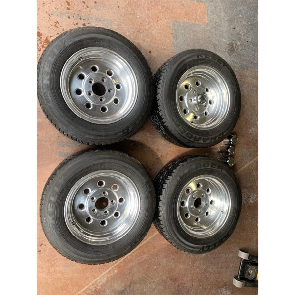 NO RESERVE! Set of four 15 inch five and three-quarter mag wheels with like new tires