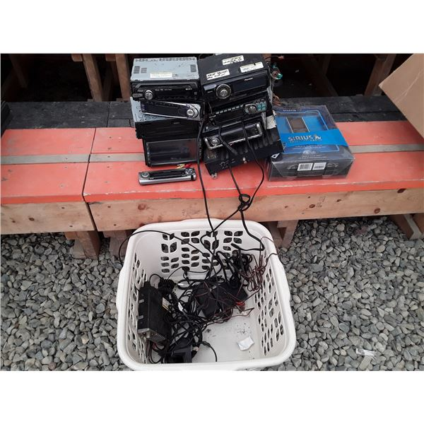 Basket full of Automotive stereos and more
